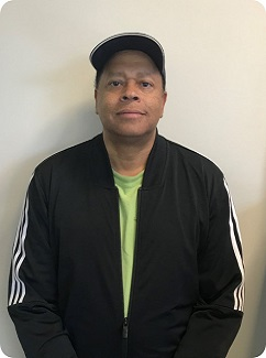 Success Story Client - man in black baseball cap and jacket