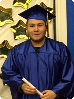 Anthony in cap and gown - success client